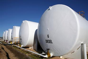 photo: white aboveground tanks