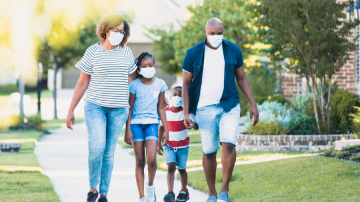 Family walking with masks on
