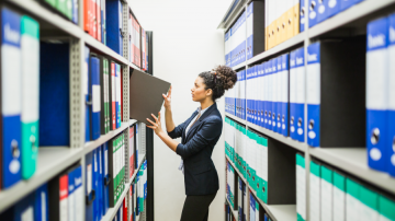 Woman looking through shelves of records